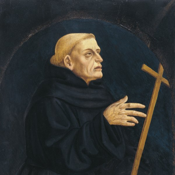 Monk holding a Cross